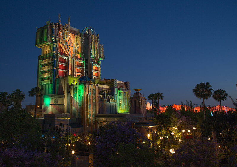 The exterior of The Collectorís Fortress shimmers as night falls at Disney California Adventure Park